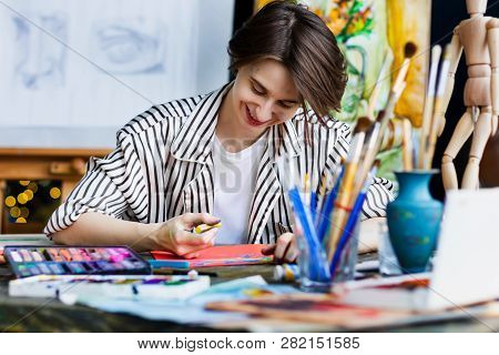 Young Beautiful Smiling Artist Teacher Student Woman Girl Boy In Art Workshop Studio Surrounded By C