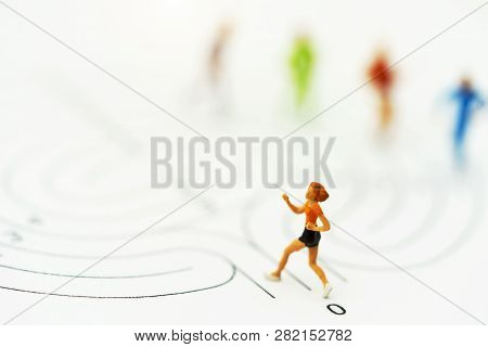 Miniature People Running On Start Point Of Maze And  Thinking How To Solve This Problem. Concepts Of