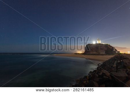 An Illuminated Noght View Of Nobbys Lighthouse - Newcastle Nsw Australia. This Lighthouse At The Mou