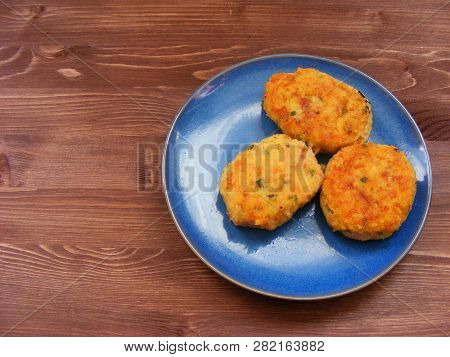 Rissoles Of Ham, Cheese  And Potatoes On Blue Plate On Rustic Wooden Background