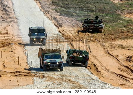 Nato Soldiers And Military Vehicles. International Military Training