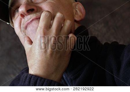 Low Angle Shot Of Uncertain Man Scratching His Face, Studio Porrait