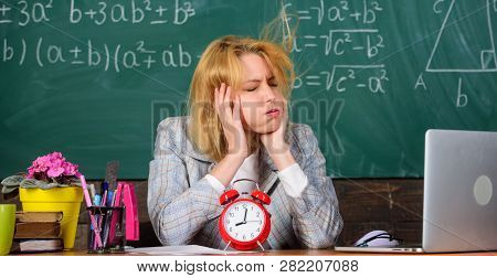 Teacher With Alarm Clock At Blackboard. Time. Woman In Classroom. Back To School. Teachers Day. Stud