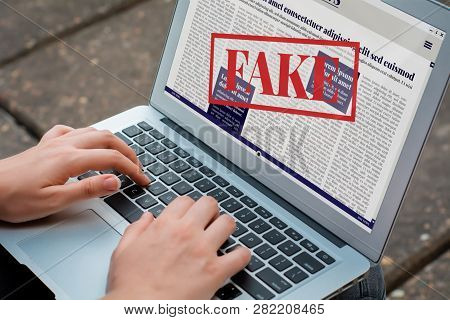 Closeup Of Young Woman Reading Digital Fake News On Laptop. Propaganda And Disinformation Online. Me
