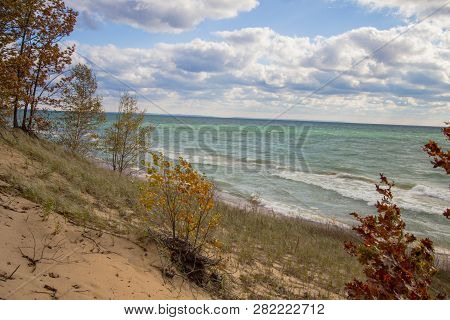 Lake Michigan Beach. View From The Top Of A Lake Michigan Sand Dune Over The Sunny Blue Waters Of La