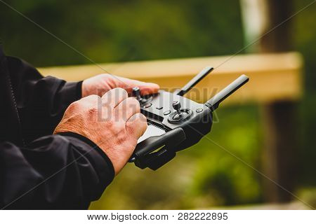 Hand Holding Drone Quadcopter Uav Remote Control Console Controls.