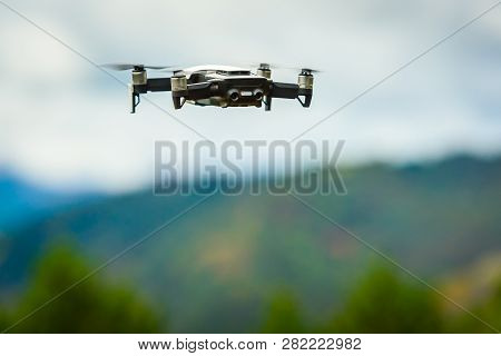 Drone Quadcopter Uav With Digital Camera Flying In The Sky.