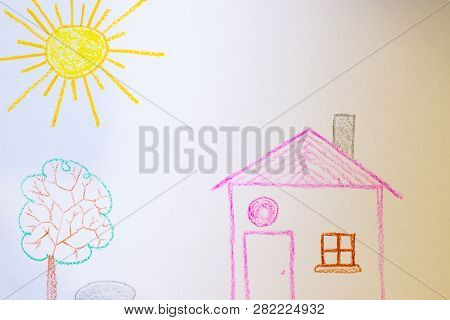Children`s Drawing Of House, Tree, Sun And Rock On White Paper. Kindergarten Age Drawings.