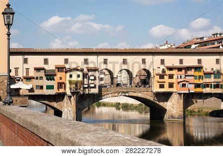 Bridge over river Arno of ancient Tuscany city, Italy. Historical Florence is a UNESCO World Heritage Site. poster