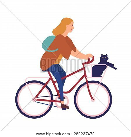 Pretty Young Woman Dressed In Casual Clothes Riding Bike With Cat Sitting In Basket. Cute Girl On Bi