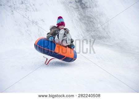 .child Sledding Cheesecake.sledding Off A Snow Slide