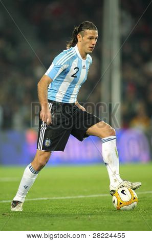 BARCELONA, SPAIN - DEC. 22: Argentinian player Martin Demichelis in action during the friendly match between Catalonia vs Argentina at Camp Nou Stadium Dec. 22, 2009 in Barcelona.