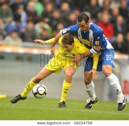 BARCELONA - MARCH 7: Fuster(L) of Villareal fight with Moises(R) of Espanyol during a Spanish League match between Espanyol and Villareal at the Estadi Cornella on March 7, 2010 in Barcelona, Spain