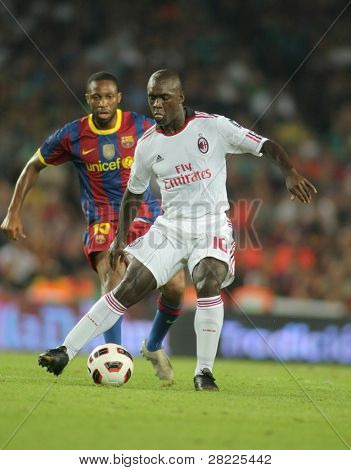 BARCELONA - AUGUST 25: Seedorf player of AC Milan in action during Trophy Joan Gamper match between FC Barcelona and AC Milan at Nou Camp Stadium on August 25, 2010 in Barcelona, Spain.