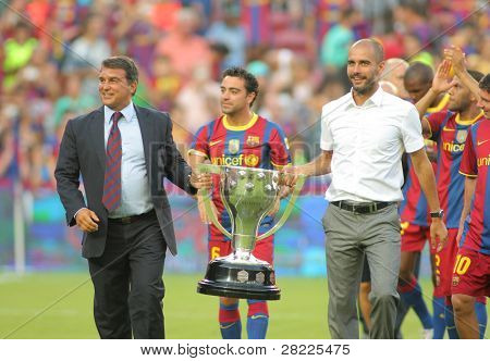 BARCELONA - AUGUST 25: President Laporta and Manager Guardiola celebrate the league trophy for FC Barcelona at Nou Camp Stadium on August 25, 2010 in Barcelona, Spain.