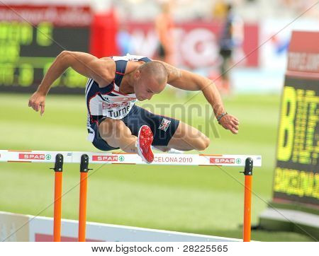 BARCELONA, SPAIN - JULY 29: Andy Turner of Great Britain competes on the 110m Hurdles event during the 20th European Athletics Championships at the Stadium on July 29, 2010 in Barcelona, Spain