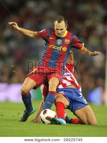BARCELONA - SEPT 22: Andres Iniesta of Barcelona in action during Spanish league match between FC Barcelona and Sporting Gijon at Nou Camp Stadium in Barcelona, Spain. September 22, 2010