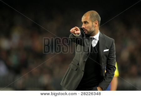 BARCELONA - JAN 2: Josep Guardiola of Barcelona during a Spanish League match between FC Barcelona and UD Levante at the Nou Camp Stadium on January 2, 2011 in Barcelona, Spain