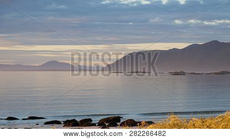 Coast Of Gimsoya Island, Gimsoysand Sandy Beach And Mountains On Horizon. Nordland County, Lofoten A