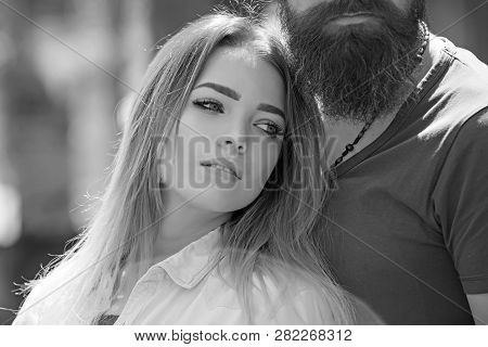 She Belongs To Him. Sensual Woman With Long Hair And Makeup Look. Sexy Woman And Bearded Man In Love