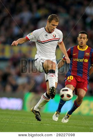 BARCELONA - APRIL 23: Krisztian Vadocz of Osasuna in action during the match between FC Barcelona and Osasuna at the Nou Camp Stadium on April 23, 2011 in Barcelona, Spain