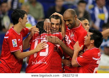 BARCELONA - MAY 21: Alfaro, Negredo, Kanoute and Medel of Sevilla FC Celebrates goal during a league match between RCD Espanyol and Sevilla at the Estadi Cornella on May 21, 2011 in Barcelona, Spain