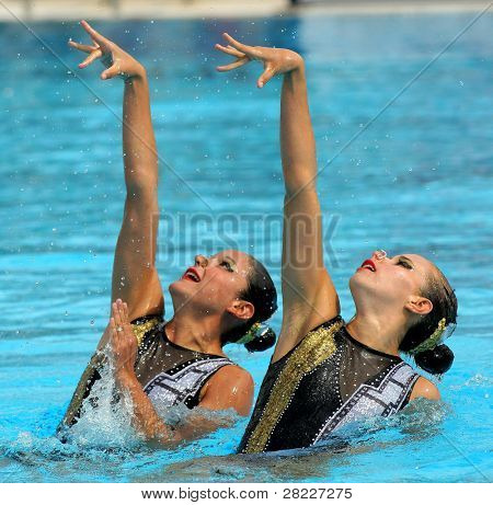 BARCELONA -JUNE 18: Mexican synchro swimmers Mariana Cifuentes and Isabel Delgado in a Duet exercise during the Espana Sincro meeting in Barcelona Picornell Swimpool, June 18, 2011 in Barcelona, Spain