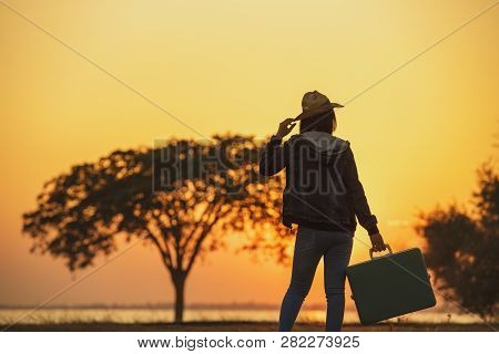 Independent Travel.young Woman Traveler With A Luggage