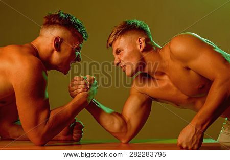 Revenge In Sport. Twins Men Competing Till Victory. Strength Skills. Twins Competitors Arm Wrestling