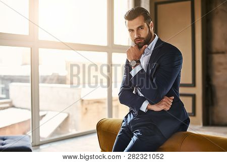Developing A New Idea...handsome And Successful Businessman In Stylish Suit Is Thinking About Someth