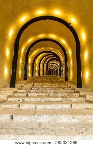 Valletta, Malta - December 55, 2013: Illuminated Tunnel Entrance Leading To The St James Cavalier Ce