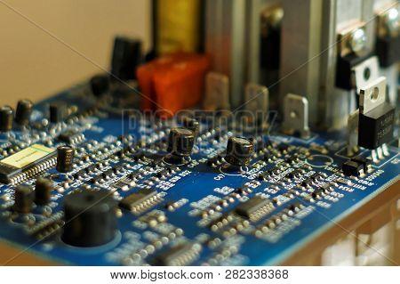 Electrons Metropolis. Piece Of Electronic Equipment - Microchips, Capacitors, Transistors, Resistanc