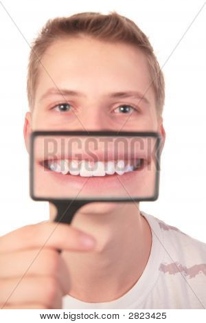 Man Shows Smile Through Magnifier