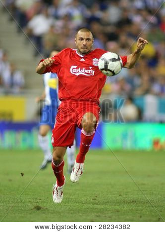 BARCELONA - AUGUST 2: Andrea Dossena, Italian player of Liverpool FC, in action during a friendly match against RCD Espanyol at the Estadi Cornella-El Prat on August 2, 2009 in Barcelona, Spain.