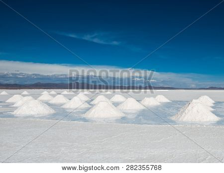 Sunshine scenery of area with salt banks in Salar de Uyuni in Bolivia