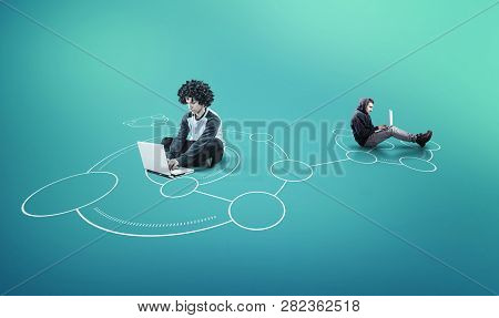 Two Man Working Together On Laptop In A Network