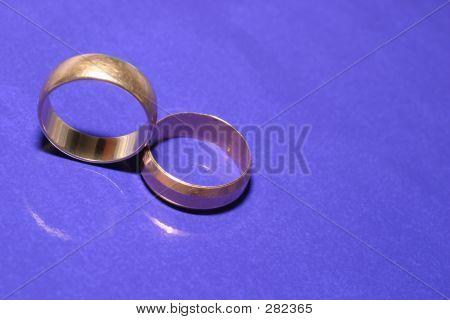 Wedding Rings Over Blue