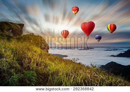 Colourful Hot-air Balloons Flying Over The Mountain At Phucheefa,chiangrai Province ,north Of Thaila