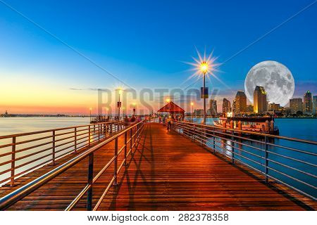 Scenic Twiligtht View Of Coronado Wooden Pier With Docked Ferry Boat On Coronado Island, California,