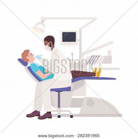 African American Dentist Examining Male Patient Lying In Chair. Dental Surgeon Treating Man Isolated