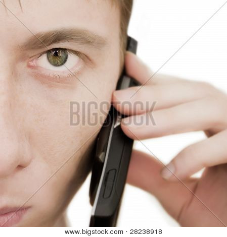 Closeup of young man holding a mobilephone