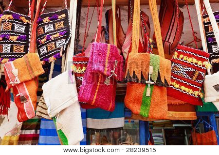 Colorful bags in a market in the street