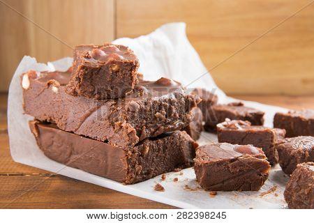 Chocolate Cake (fudge) With  Hazelnuts On Wooden Background