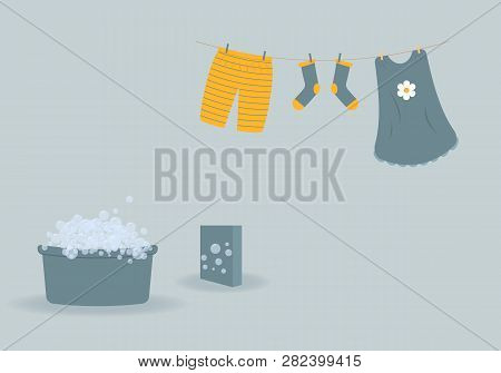 Washing: Washed Baby Clothes Cute Capri Pants,socks And Dress Hanging On Clothesline And They Are At