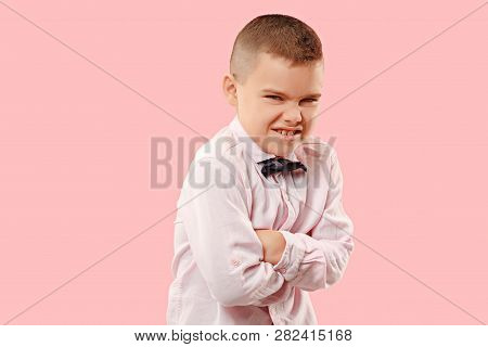 The Hate, Rage. The Emotional Angry Teen Boy On Pink Studio Background. Emotional, Young Face. Male