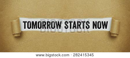 Torn Brown Paper Revealing The Words Tomorrow Starts Now