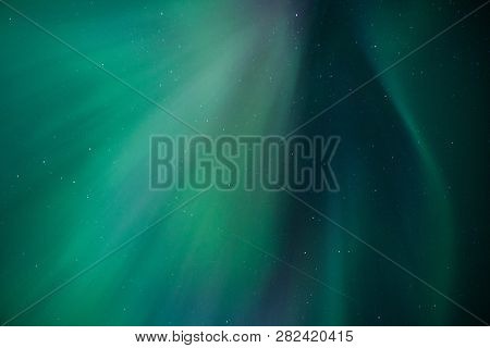 Stripes Of Northern Light On The Night Sky Far North