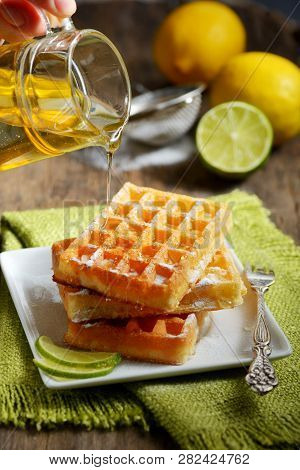 Waffles With Honey And Lemon Slices, Close Up