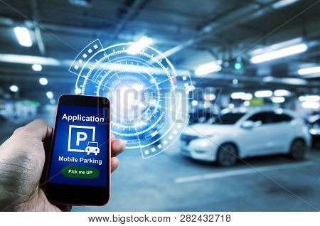 Pick Me Up, Mobile Smart Phone In Hand Using Application For Intelligent Car Park With Digital Holog