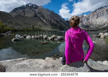 Fit Attractive Female Sits Alone By Convict Lake In The Springtime, Located Off Of Us-395, Near Mamm